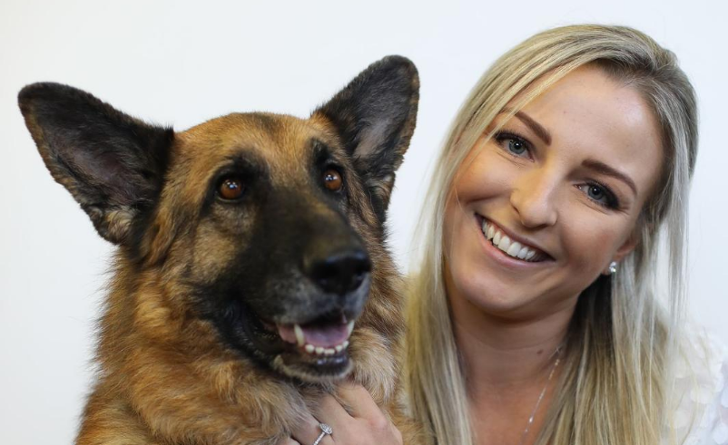 Professional image of ABA Legal Group's Associate Director Toni Dickson with her German Shepherd Tully.