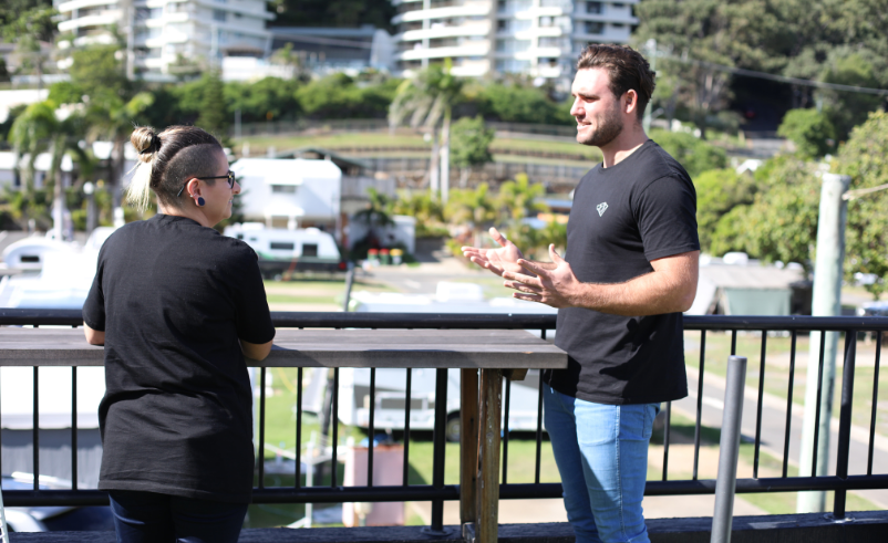 Queensland transfer duty exemption for small business restructures. Two ABA employees discussing the exemption on the rooftop terrace.
